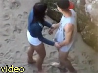 horny lovers caught behind the rocks on the beach